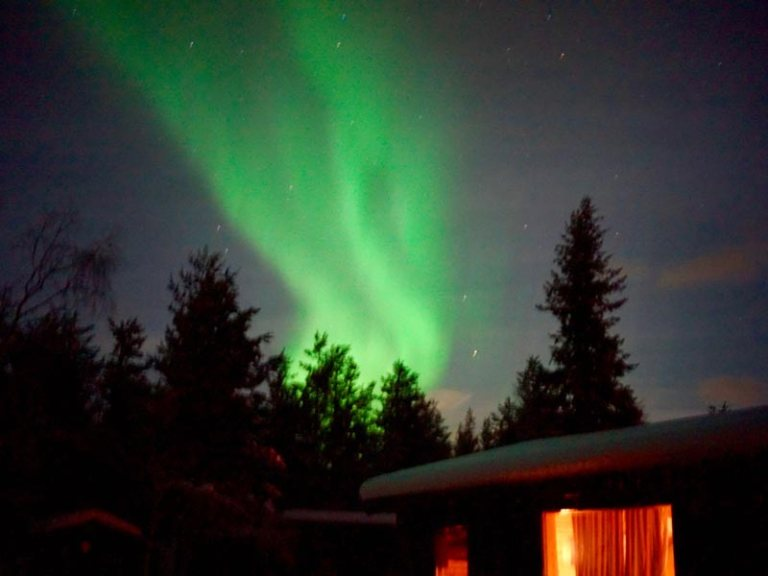 Northern Lights at cabin on dogsled tour